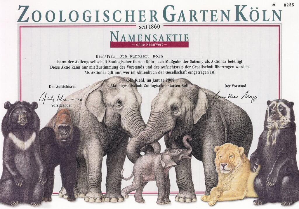 Zoo Köln, Namensaktie ohne Nennwert von 2002. Sehr dekoratives Papier mit großer Abbildung von Elefanten, Löwen, Gorilla und Bären. Heute mit über 20 ha einer der modernsten deutschen zoologischen Gärten.